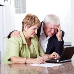 senior couple worrying about money