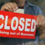 stock-footage-going-out-of-business-closed-sign-on-window